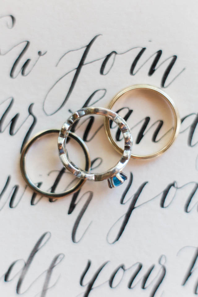 Wedding rings on calligraphy | Katlyn Marie PhotoArt