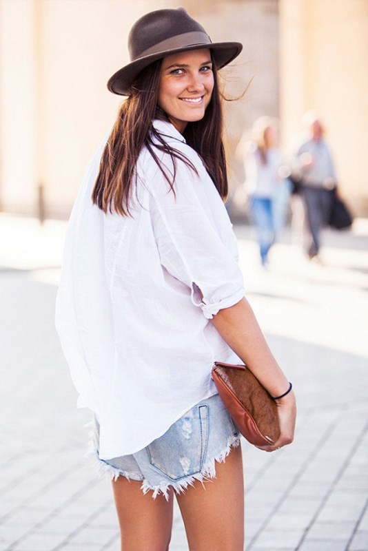 Frayed Jean Shorts And An Oversized White Button Down Shirt