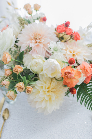Peach, blush, ivory, and green floral centerpiece | Alexis June Weddings and @aislesociety