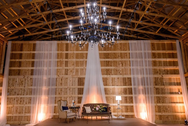 Uplighting and draping in barn