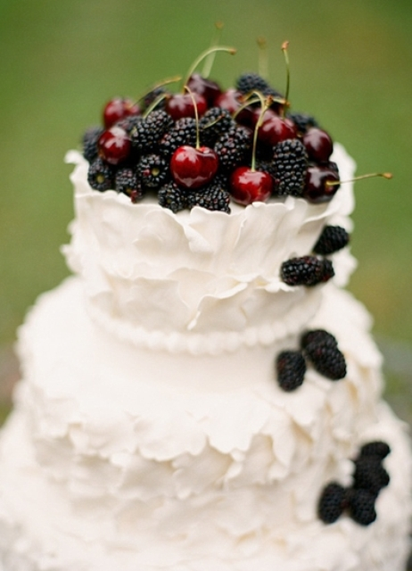 White wedding cake with blackberries