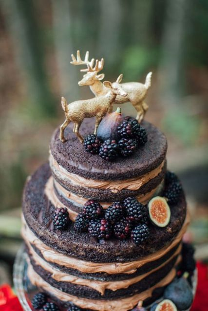 Dark wedding cake decorated with blackberries