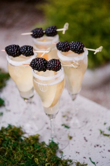 Glass of champagne with blackberry decor