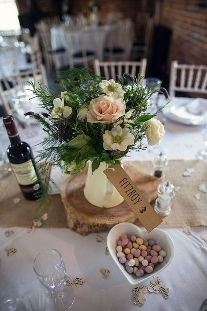 Table centerpiece with ceramic jug and flowers