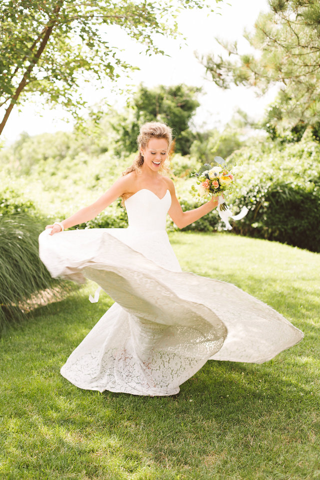 Spinning bride in wedding gown | Photography: Brooke Michelle Photography