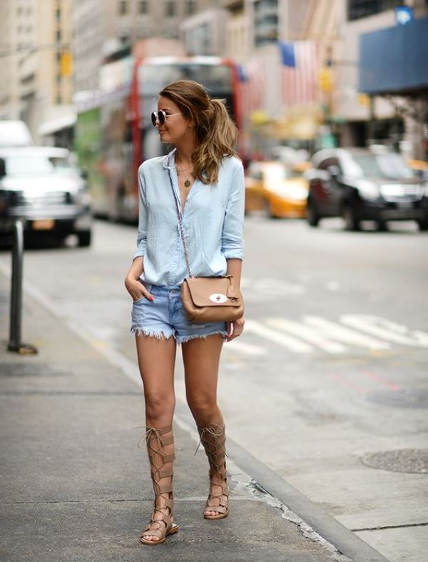 Frayed Denim Shorts With A Button Down Shirt And Laced Up Sandals