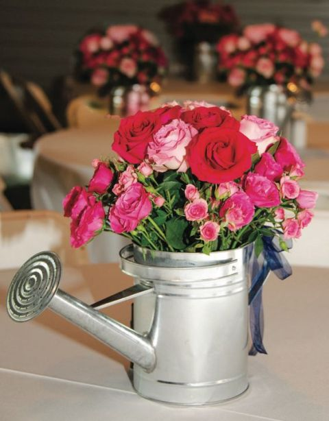 Metallic watering can decor
