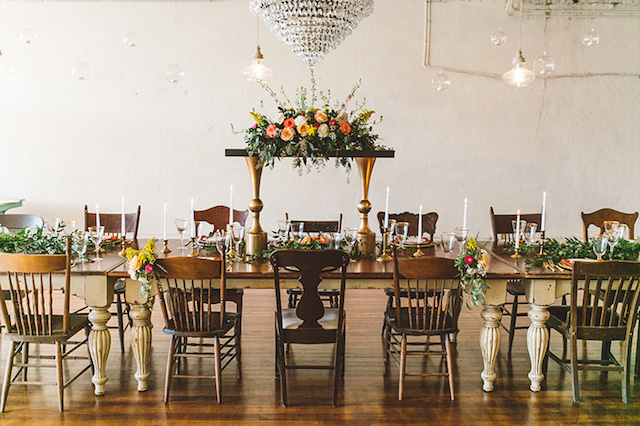 Unique floral centerpiece and family style dining wedding reception | Kate Rose Creative Group and Tim Waters Photography