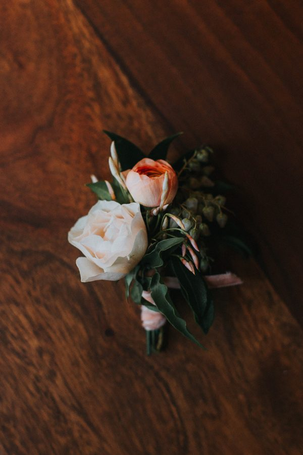 peach boutonnieres - photo by The More We See http://ruffledblog.com/cedar-lake-estate-wedding-inspiration