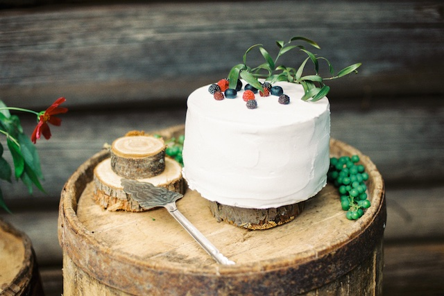 Simple white cake with blackberry accents