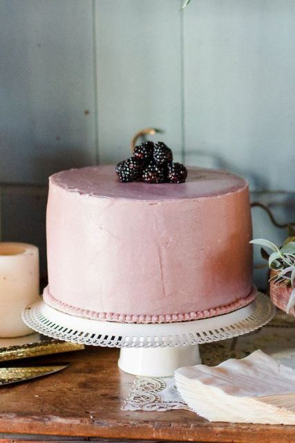 One tiered wedding cake with blackberries