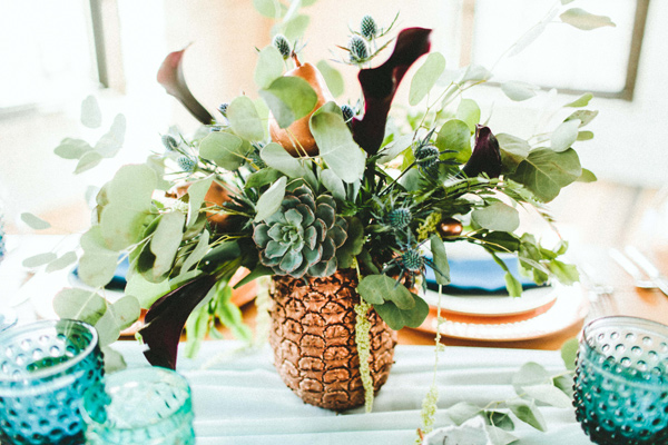copper pineapple centerpiece - photo by Giving Tree Photography http://ruffledblog.com/copper-fruit-wedding-inspiration