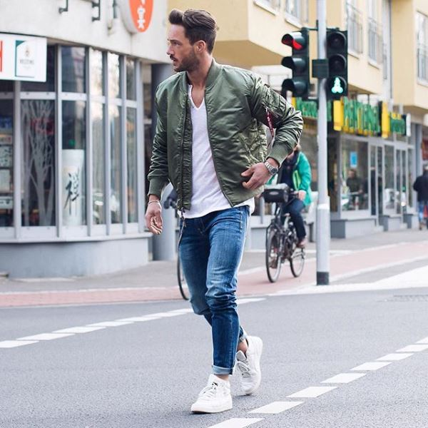 Skinny Jeans With White Sneakers And A Navy Bomber Jacket