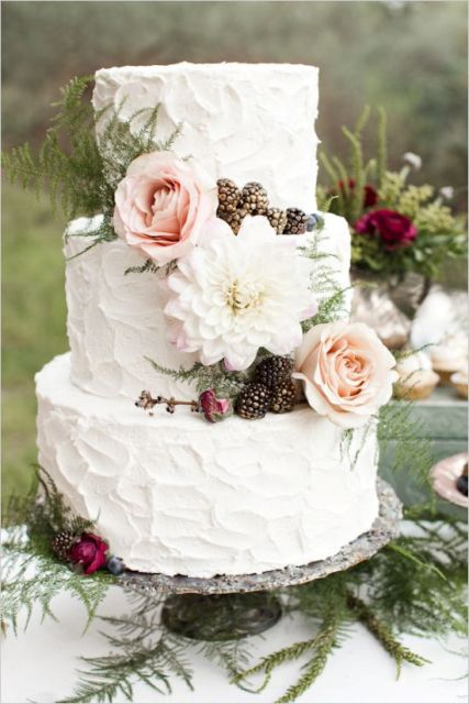 Wedding cake with flowers and blackberries