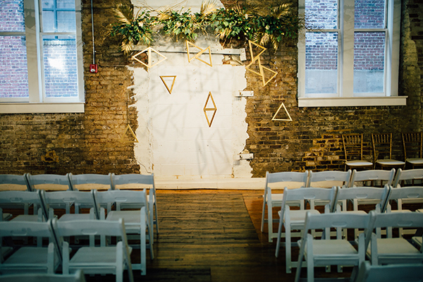 geometric wedding decor - photo by Heather Faulkner Photography http://ruffledblog.com/golden-sands-wedding-inspiration