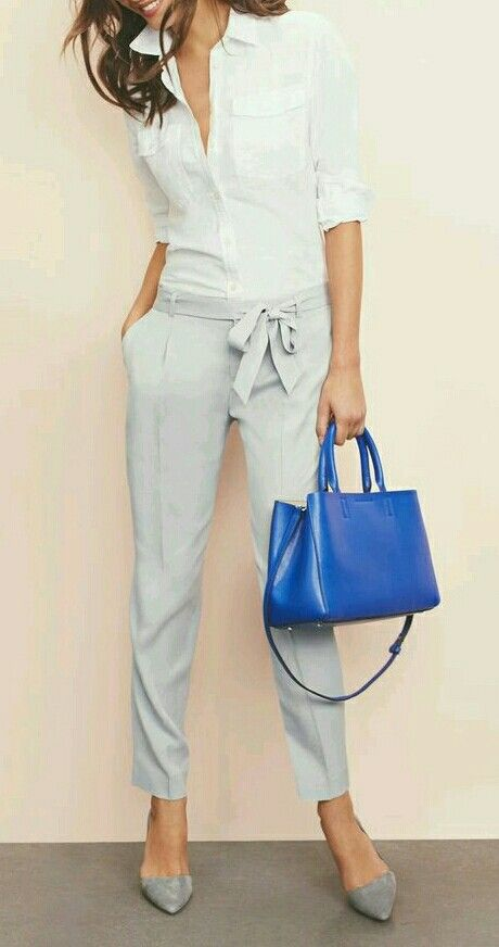 grey pants with a bow and a white shirt with an accent purse