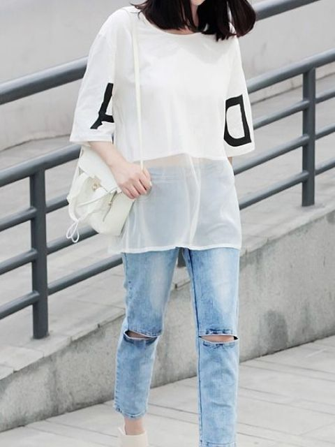 Trendy outfit with white sheer shirt and distressed jeans