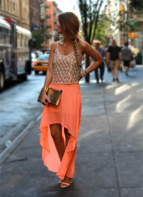 Look with high low skirt and glamorous top