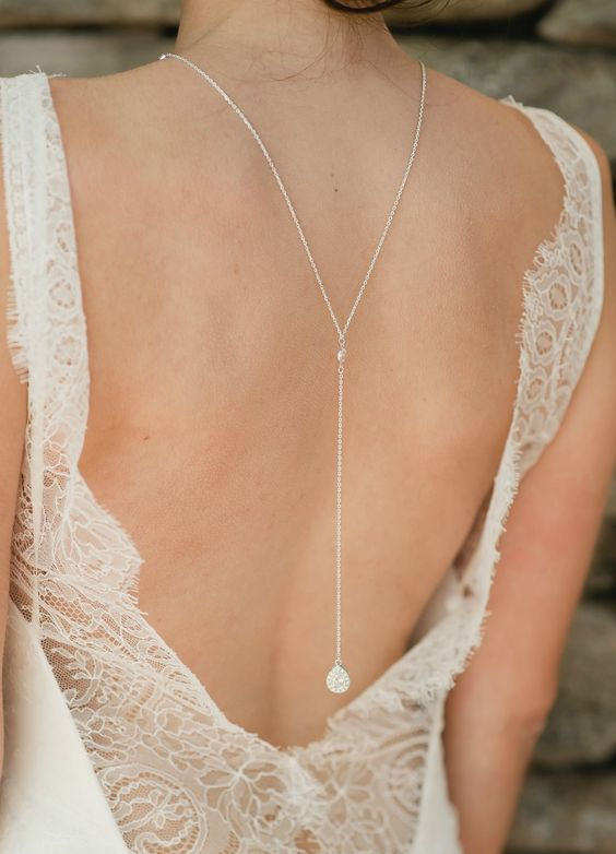 long chain necklace with a crystal charm