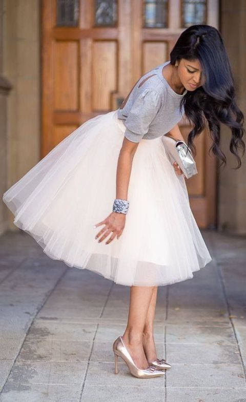 white tutu, grey cutout shirt and metallic pumps