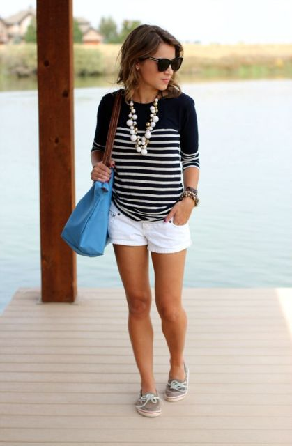 White shorts outfit with striped sweatshirt and tote