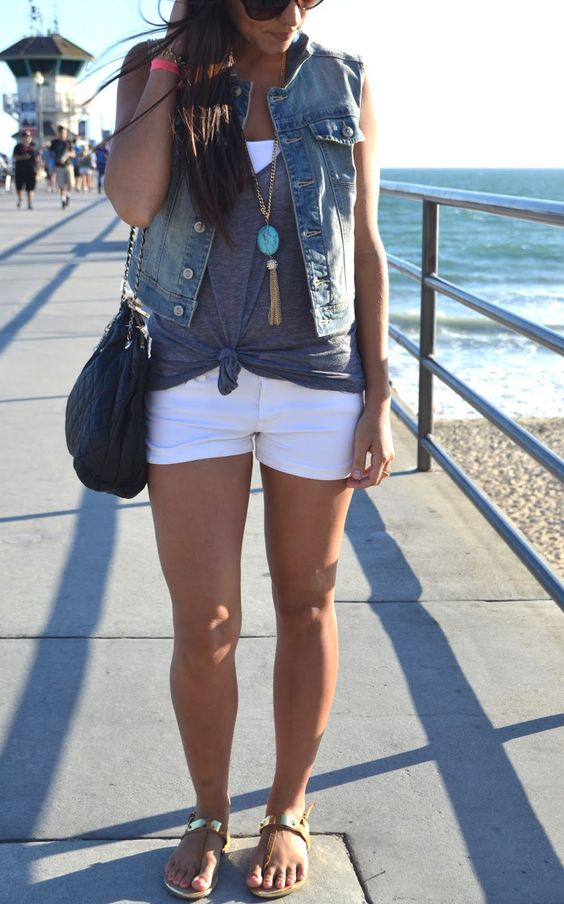 white shorts, a white top, a grey top and a denim vest