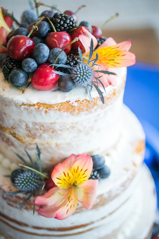 Berry and cherry topped wedding cake   Rachael Hall Photography