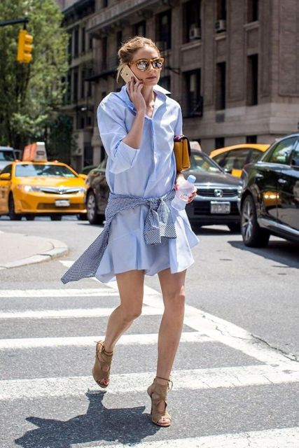 Look with mini denim shirtdress and bright clutch