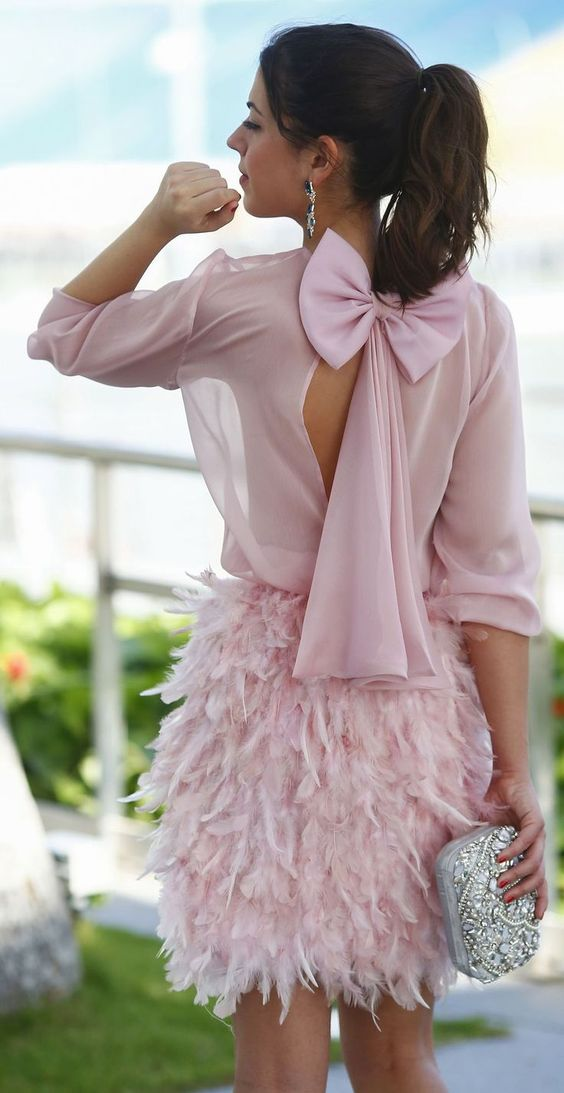 pink back bow dress with a feather skirt