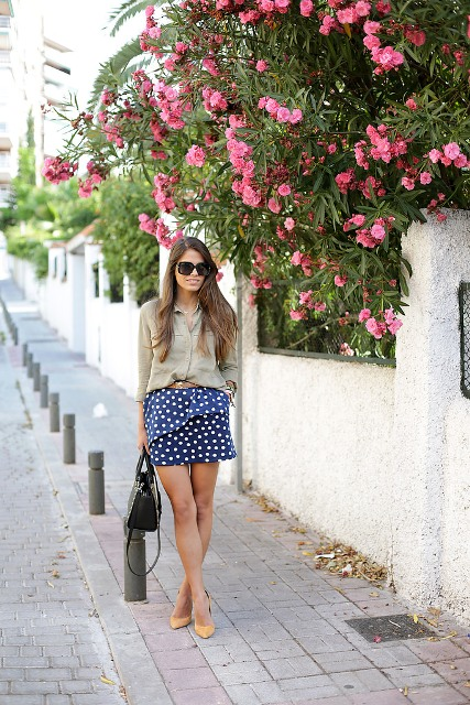Trendy look with blouse and peplum polka dot skirt