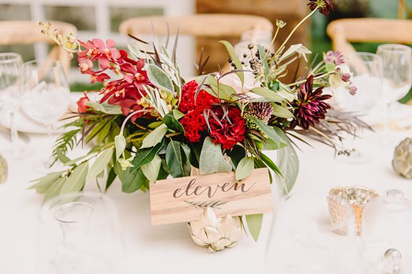 wooden table numbers - photo by L. Hewitt Photography http://ruffledblog.com/heirloom-inspired-island-wedding