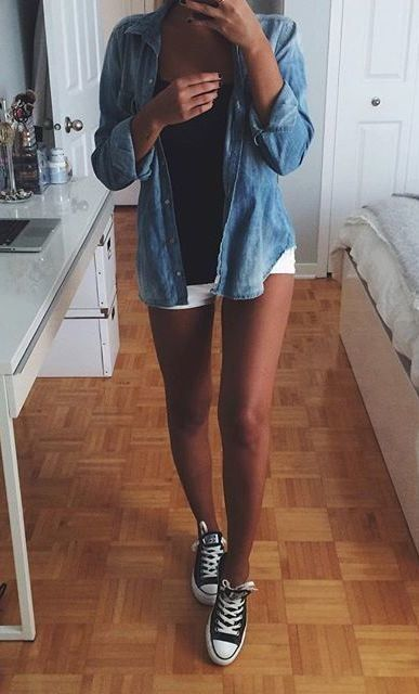 chambray shirt with a black top, white shorts and black converse