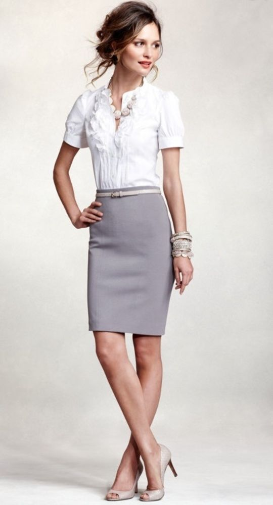 white button down and a grey skirt with a skinny belt