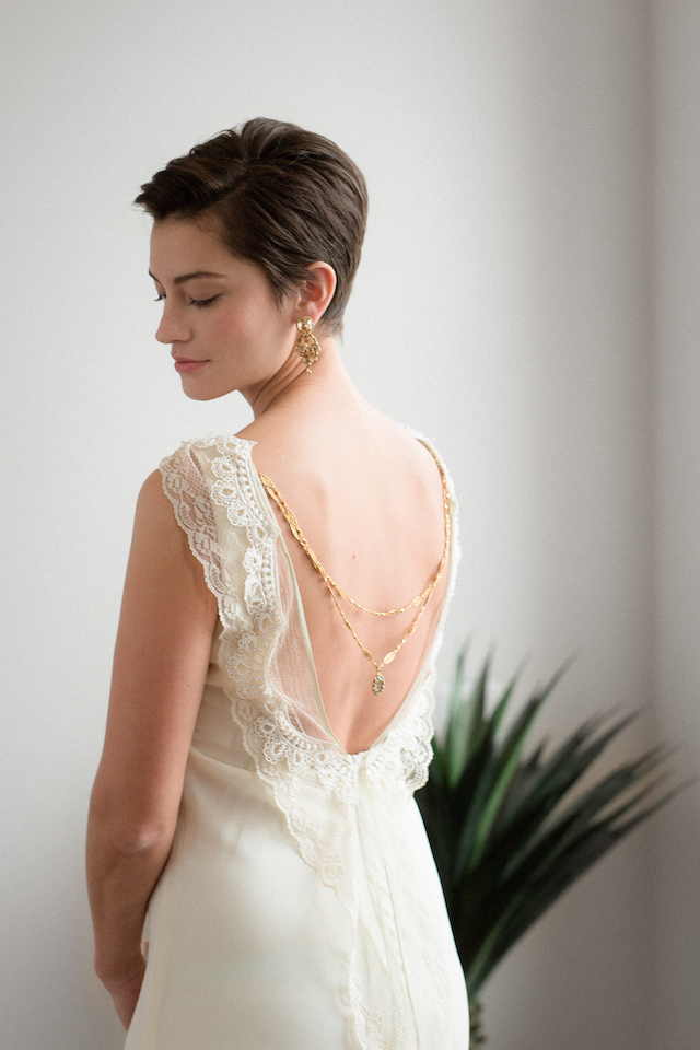 wedding dress with back necklace | Photography: Loren Weddings