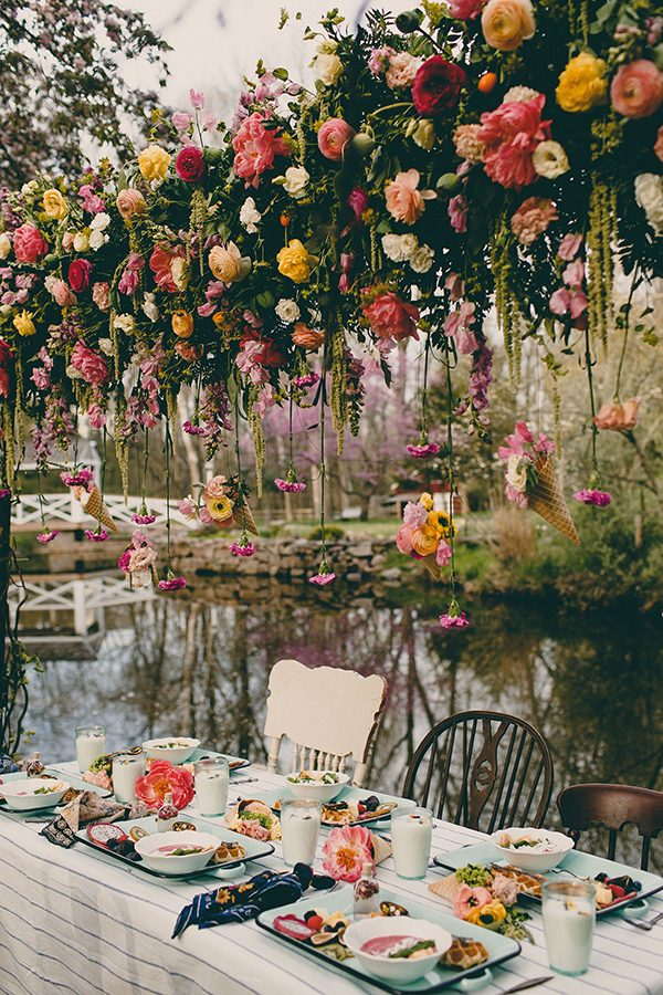 hanging flower decor - photo by Tree of Life Films http://ruffledblog.com/summer-brunch-wedding-inspiration