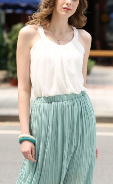 soft summer layering of a white top and a pleated skirt