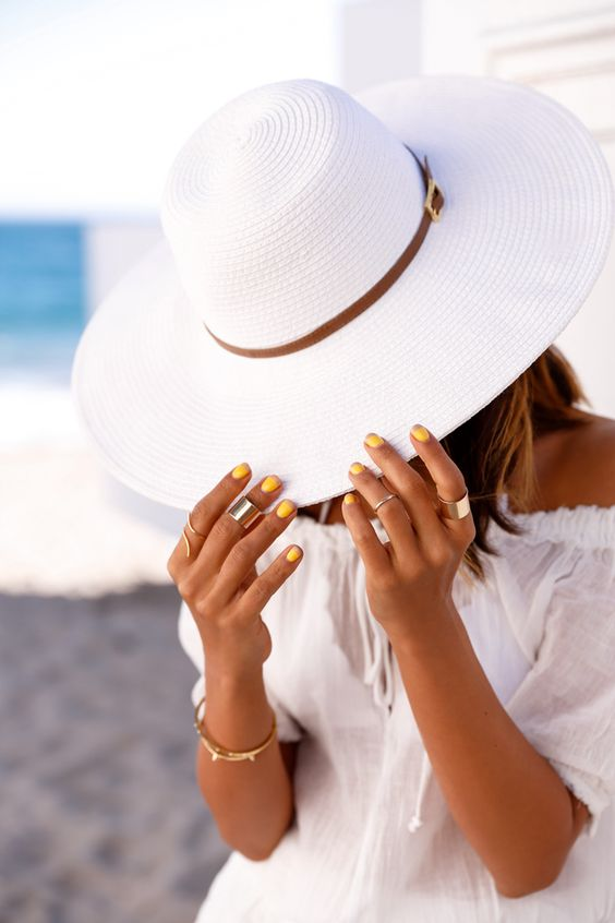 a wide brimmed white hat