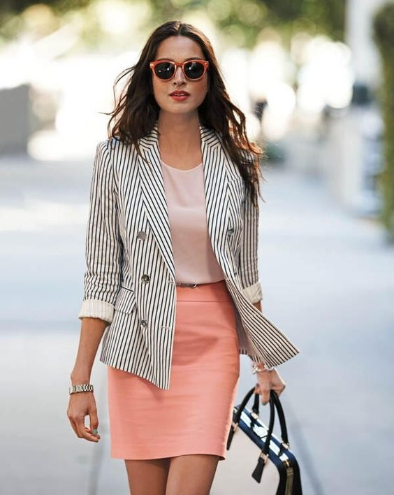 peach colored skirt with a striped jacket and a simple top