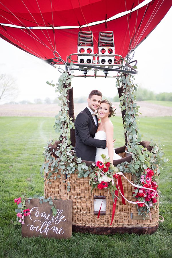 red wedding inspiration - photo by Elizabeth Moore Photography http://ruffledblog.com/come-fly-away-with-me-wedding-inspiration