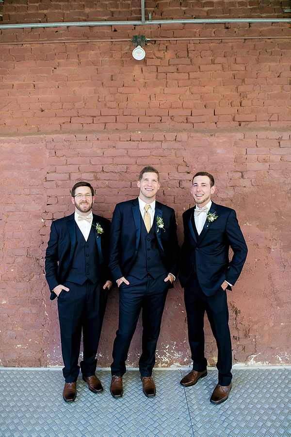 navy blue suits - photo by Katherine Birkbeck Photography http://ruffledblog.com/golden-sands-wedding-inspiration