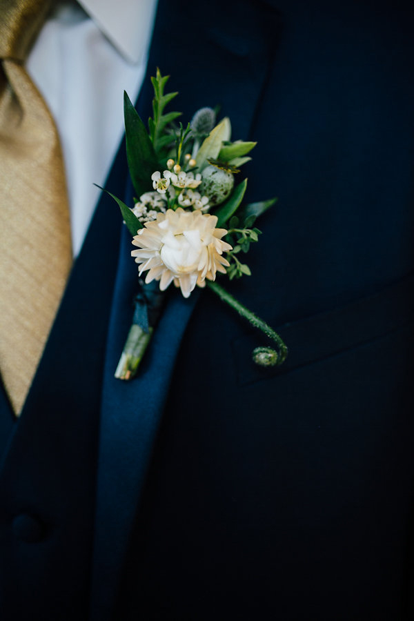 unique wedding boutonnieres - photo by Heather Faulkner Photography http://ruffledblog.com/golden-sands-wedding-inspiration