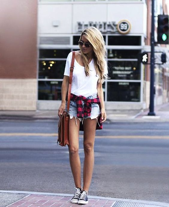 distressed denim shorts, a white tee, a checked shirt and converse