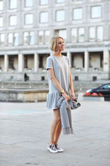 Look with drop waist dress and slip on sneakers