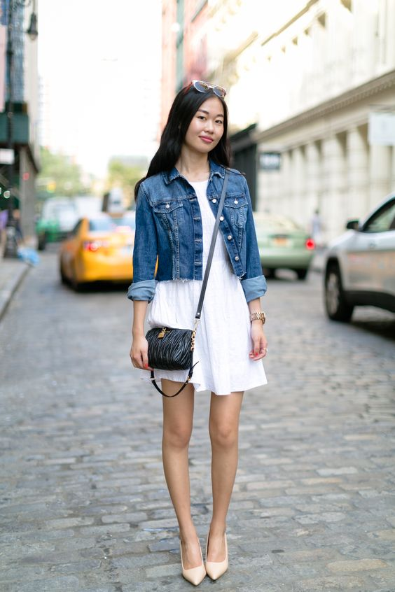flowy white dress with a denim jacket on top