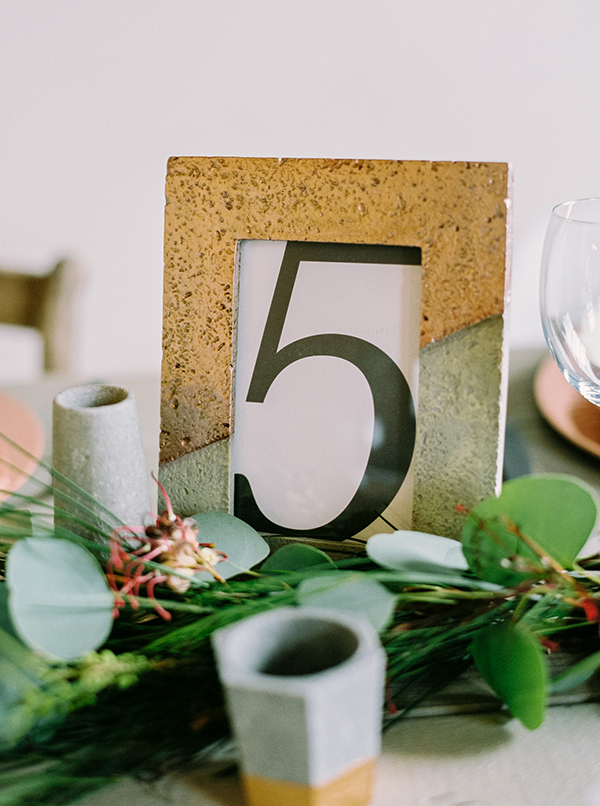 unique table numbers - photo by Milton Photography http://ruffledblog.com/industrial-greenhouse-wedding-ideas