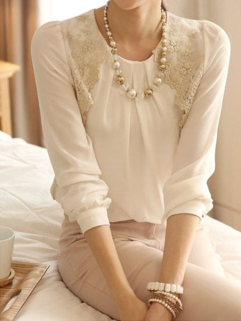 blush skirt, lace white blouse and a pearl necklace