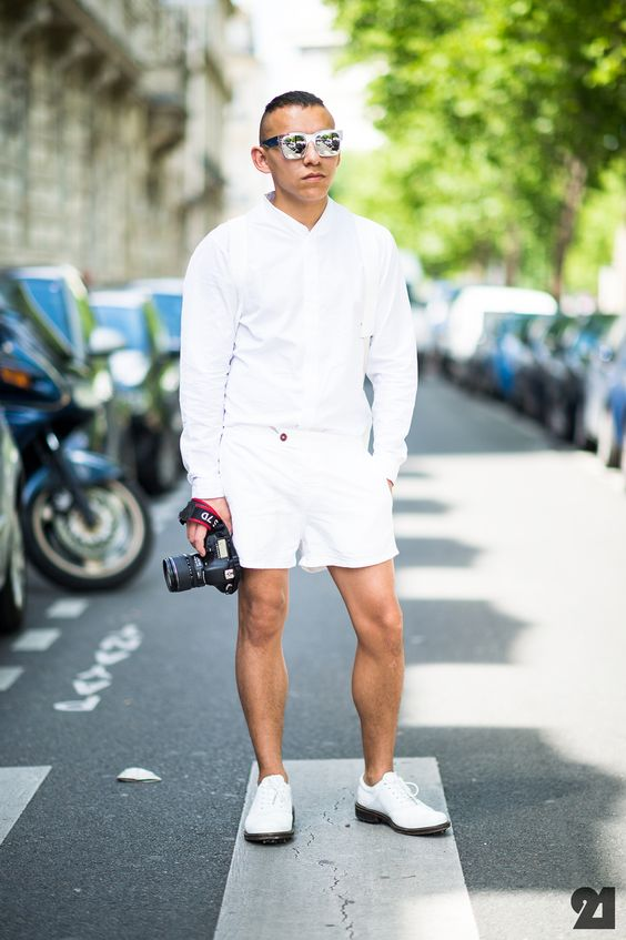white shorts and a long sleeved shirt with white shoes