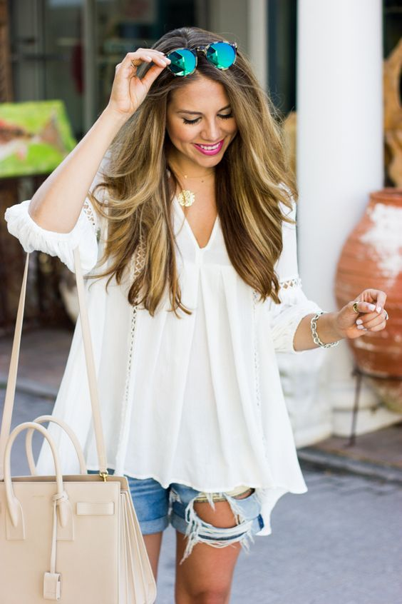 loose white tunic with distressed denim