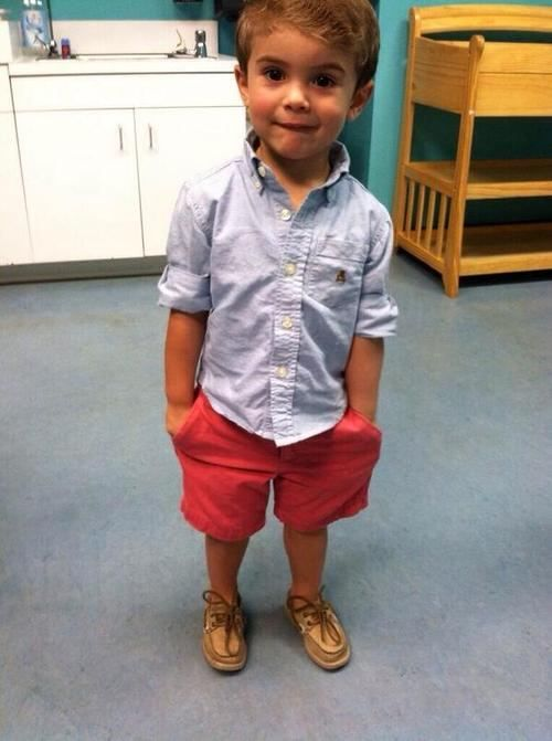 red shorts, a chambray shirt and shoes