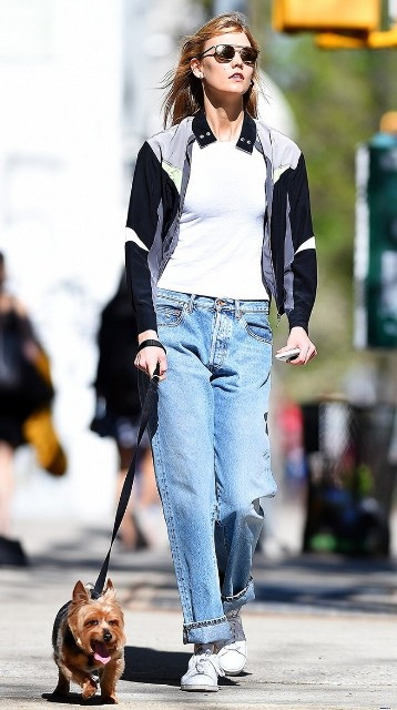 Outfit with cuffed low slung jeans and sporty jacket